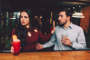 A couple sitting in a bar
